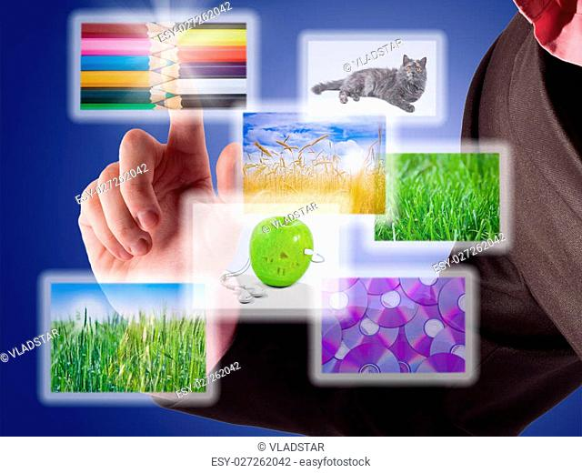 Man's hand selects among several images