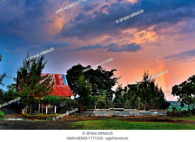 France, Reunion island (French overseas department), Saint Louis, Maison Rouge area, Creole house under a stormy sky with rainbow