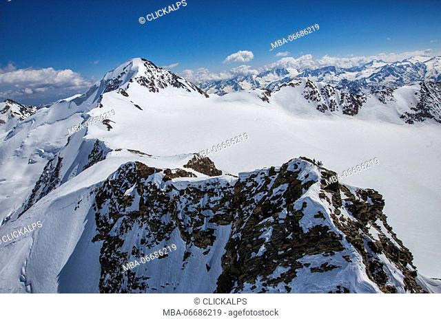 Aerial view of alpine skiers on peaks Dosegu and San Matteo Stelvio National Park Valtellina Valfurva Lombardy Italy Europe