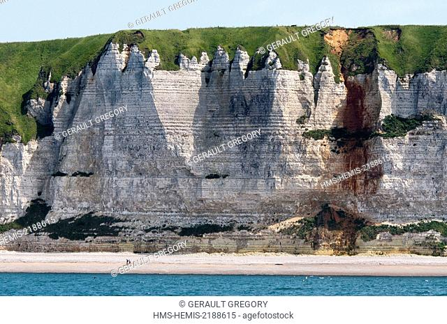 France, Seine Maritime, Pays de Caux, Cote d'Albatre, Fecamp, two people on the beach at the foot of cliffs