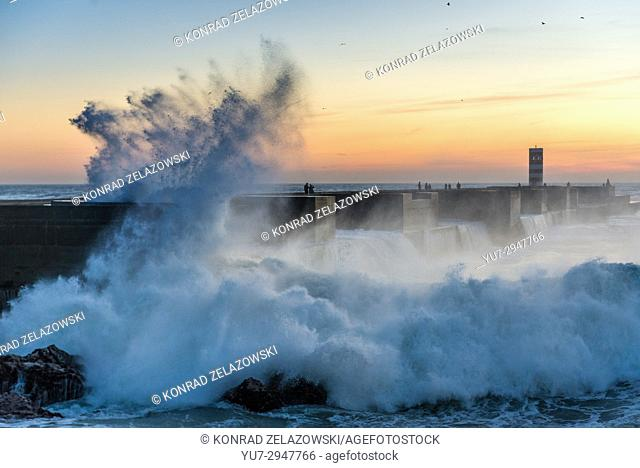 Spectacular wave crash on rocks seen from breakwater in Foz do Douro district of Porto city, second largest city in Portugal