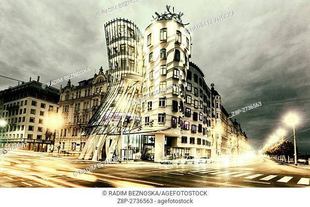 Illuminated The Dancing House designed by Frank Gehry, evening dusk, Prague, Czech Republic, Europe