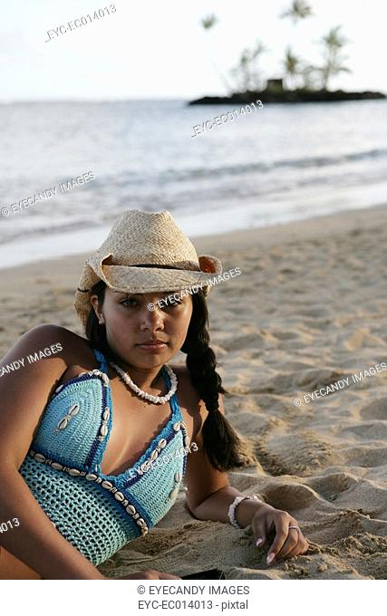 Portrait of a woman relaxing on a beach