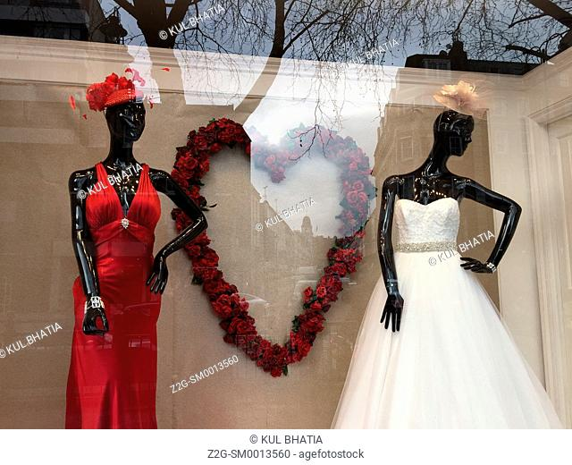 Two bridal gowns on display around Valentine's Day in London, England