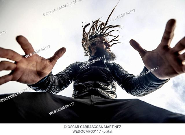 Bearded man with dreadlocks posing
