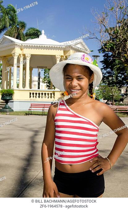 Santa Clara Cuba young girl age 10 with hat downtown in main square with Gazb=ebo or glorieta music stage for center of town