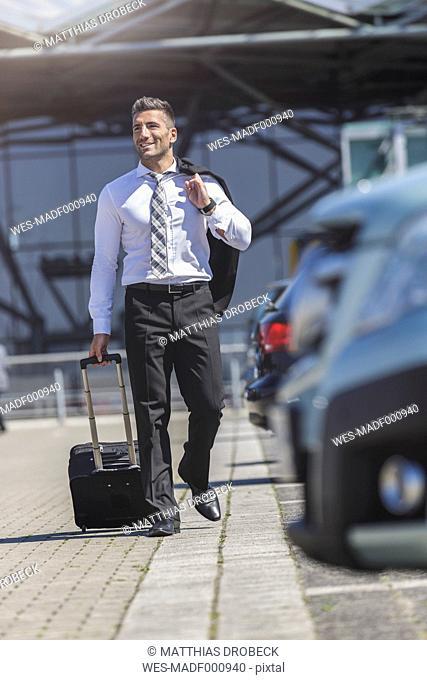 Businessman walking at car park