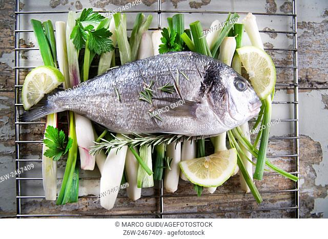 Presentation and preparation of a second dish of sea bream and onions