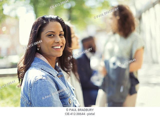Portrait smiling, confident woman in sunny park