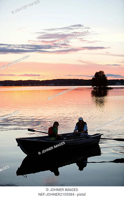 People on boat at sunset