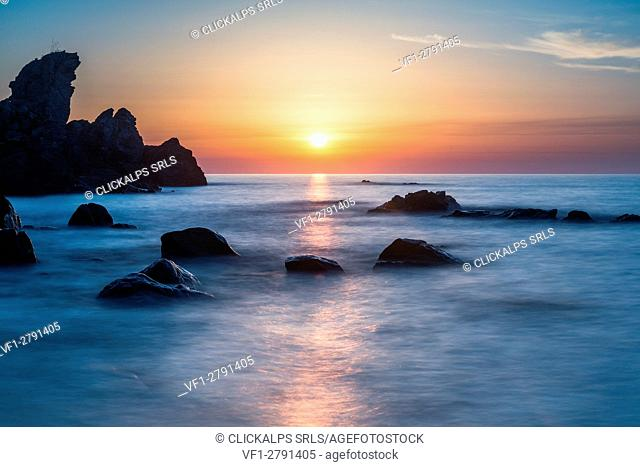 Zambrone, Calabria, Italy. Sunset on the beach of Capo Cozzo in Calabria with the Lion Rock