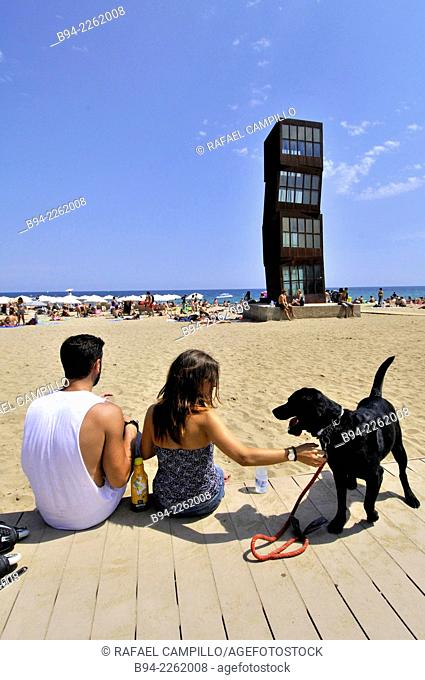 Couple with a black dog. Sculpture 'The wounded star' L'estel ferit by Rebecca Horn at Barceloneta beach, 1992. Barcelona, Catalonia, Spain