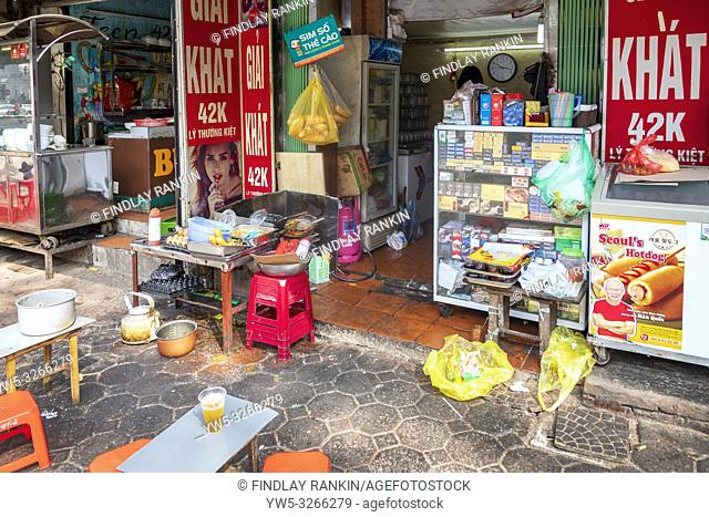 Exterior of a shop with a small cooking stove with food for sale, Hanoi Old Quarter, Ha Noi, Vietnam, Asia