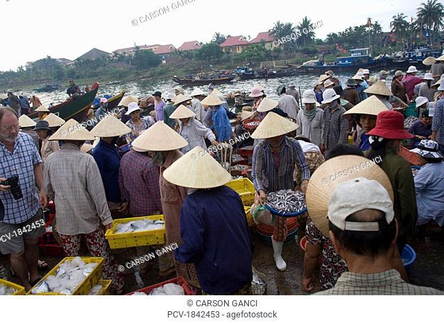 Hoi An,Vietnam,Vendors selling at an open air market