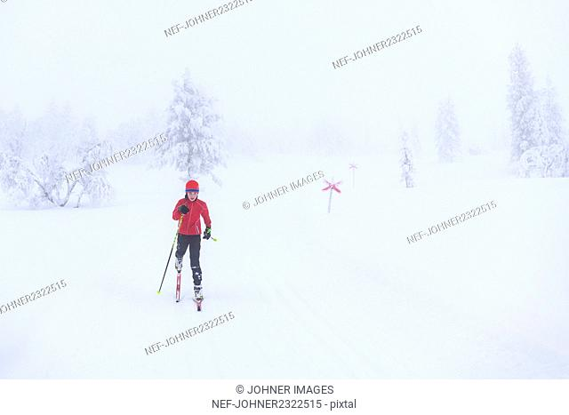 Person cross-country skiing