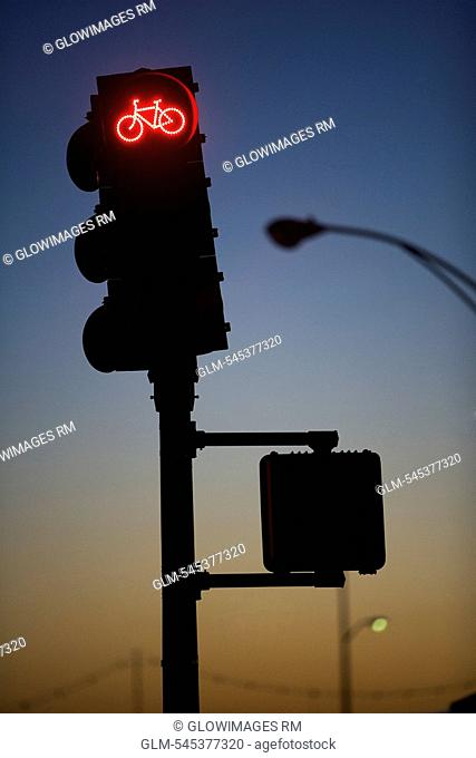 Silhouette of a traffic light at dusk, New York City, New York State, USA