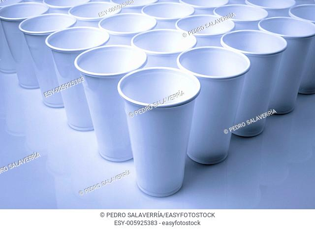 large group of white disposable plastic cups