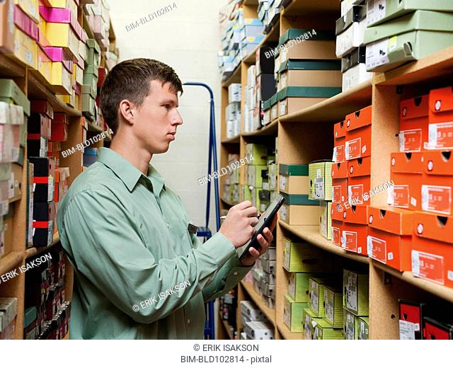 Caucasian man working in stockroom
