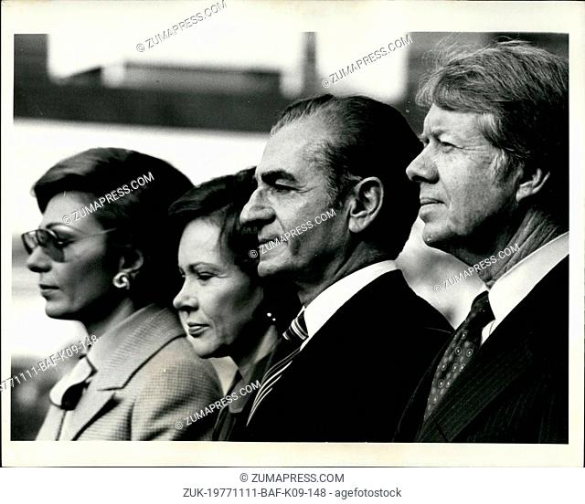 Nov. 11, 1977 - The White House-Listening to the national anthems of the U.S. and Iran during welcoming ceremonies on the south lawn of the White House are from...