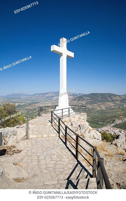 landmark of walkway towards great crucifix in Santa Catalina or St Catherine mountain, public monument and lookout balcony over Jaen city, Andalusia