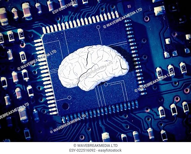 Brain in the middle of blue circuit board