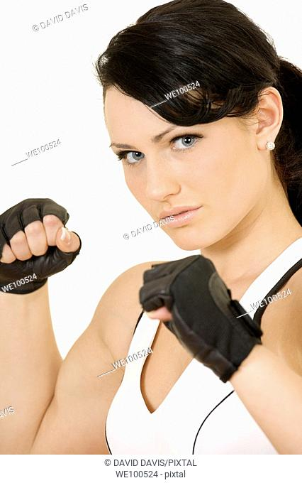 Caucasian teenager poing in work out outfit on white background