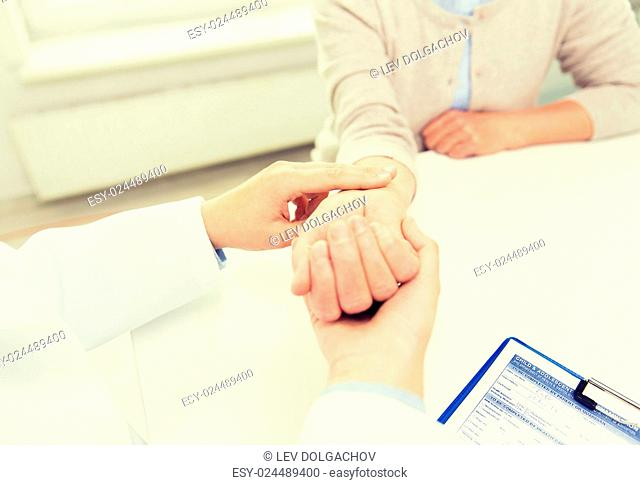 medicine, age, health care and people concept - close up of doctor or nurse checking senior woman pulse at hospital ward