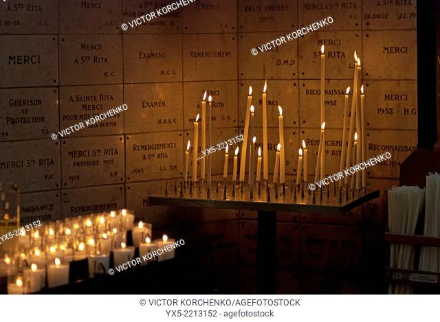 Candles burning in the church, Paris