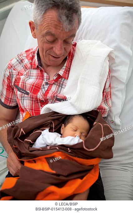 Reportage on a mainland French couple having recourse to a fa£a£amu adoption in Tahiti. Lea and her adoptive father at the maternity clinic