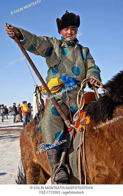 Spectator watches young riders, 25 km horse race across Gobi desert, Dalanzadgad, Mongolia