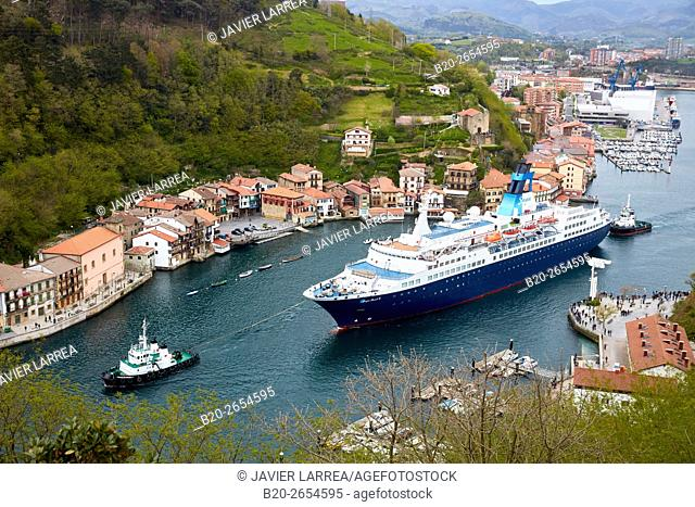 Tugboat and cruise liner. Passenger ship. Tug maneuvers. Pasaia Port. Gipuzkoa. Basque Country. Spain. Europe