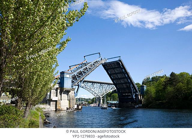 Bridge open to let boats pass  The Aurora Bridge in the background  The Fremont Bridge is a double-leaf bascule bridge that connects Fremont and 4th Avenues N...