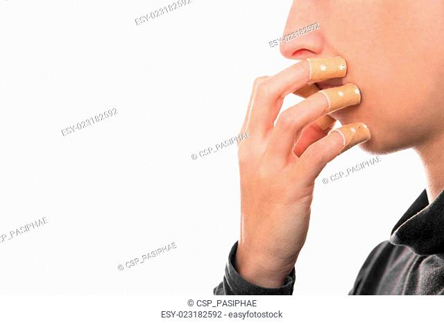 onychophagia protectet with a lot of medical pflaster on the fingernails