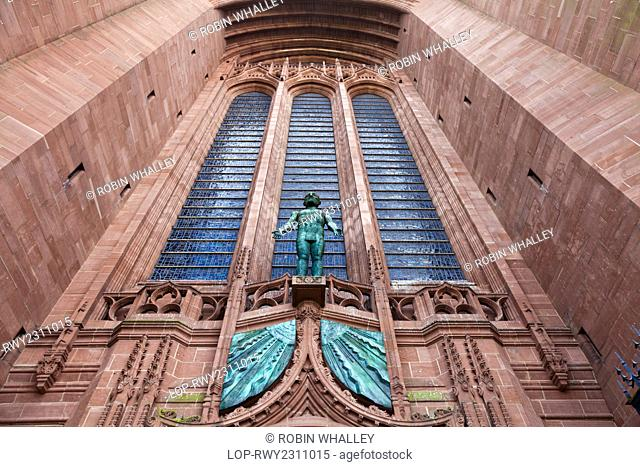 England, Merseyside, Liverpool. 'Risen Christ', a statue by Elizabeth Frink above the West door of the Anglican Cathedral