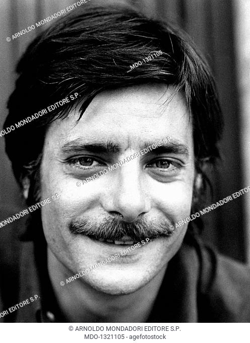 Portrait of Giancarlo Giannini smiling. Portrait of the Italian actor and voice actor Giancarlo Giannini smiling. Rome, 1970s