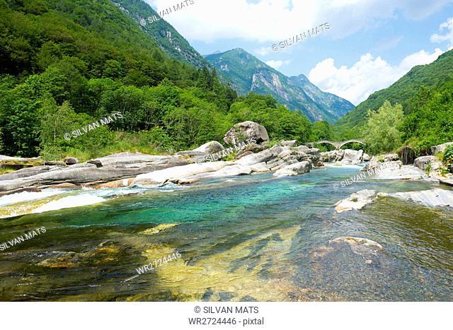 River in valley Verzasca and bridge Ponti dei Salti with mountain in a sunny day in Ticino, Switzerland