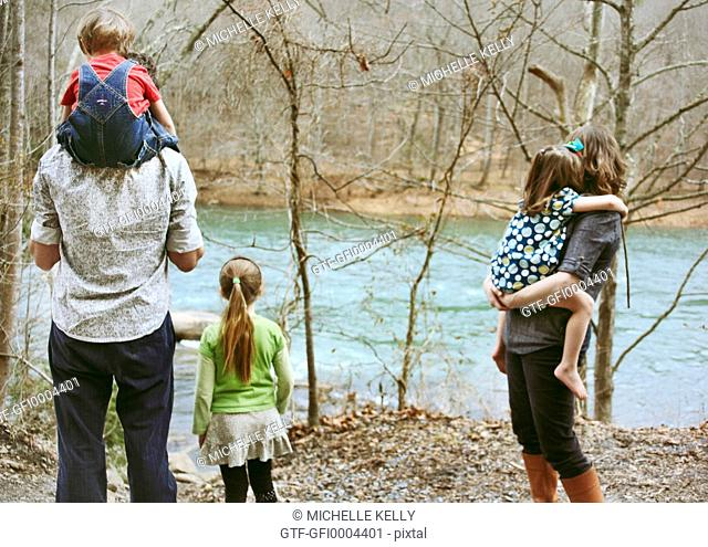 Family looking at river