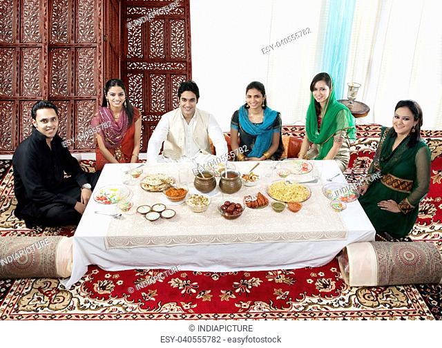 Muslim people having food during Id