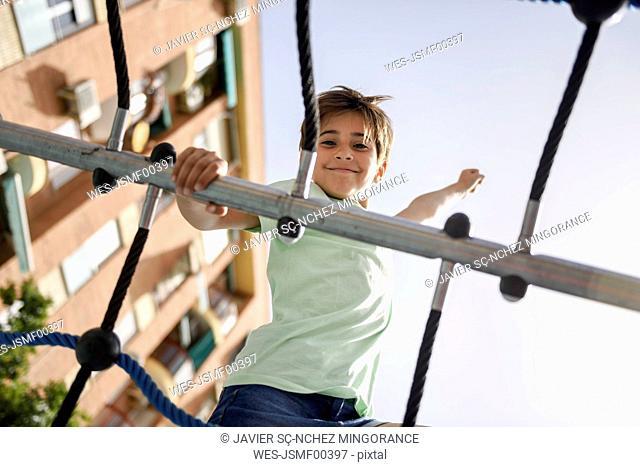 Portrait of little girl on climbing frame