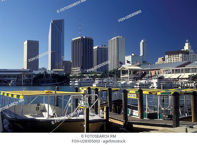 skyline, water taxi, Miami, FL, Florida, Atlantic Ocean, Yellow water taxi docked outside Bayside Marketplace, a shopping, dining, entertainment mecca