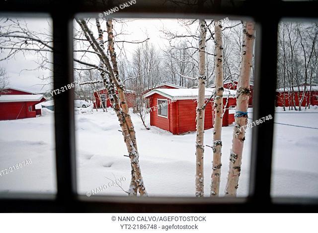 Wood cabins from VisitInari next to Lake Inari, Lapland, Finland