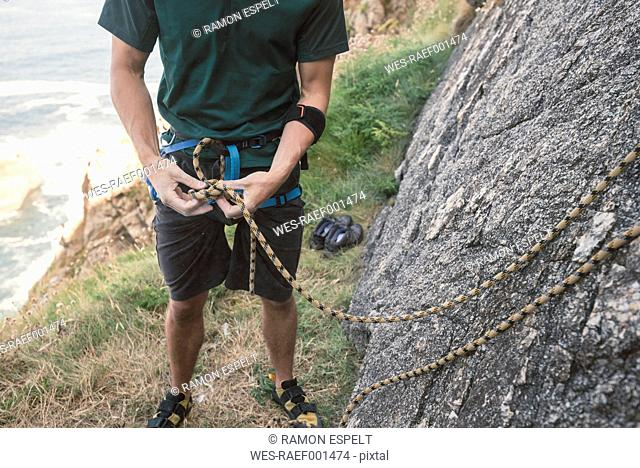 Climber preparing to climb a rock