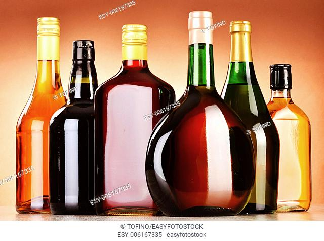 Bottles of assorted alcoholic beverages including beer and wine