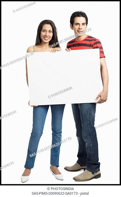 Couple holding a blank placard