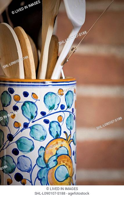 Cooking utensils in colorful vase