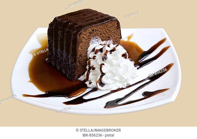 Chocolate cake with whipped cream on a white china plate