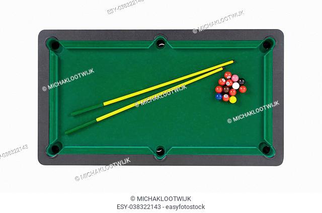 Miniature billiard table on a white background