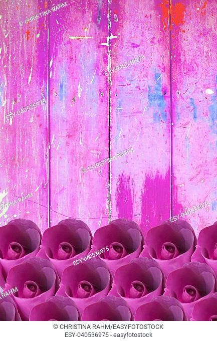 Pink vintage wood planks with roses in grungy and shabby distressed painted look in green, blue and yellow