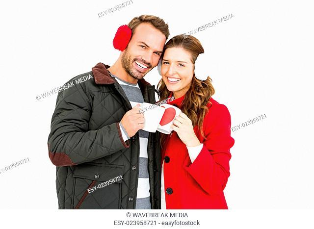 Happy young couple holding coffee mug