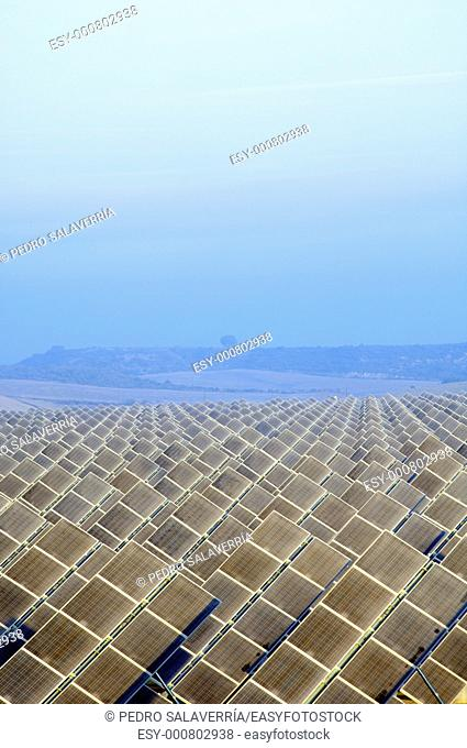 view of the dawn of a solar field with hills in the background, Zuera, Saragossa, Aragon, Spain